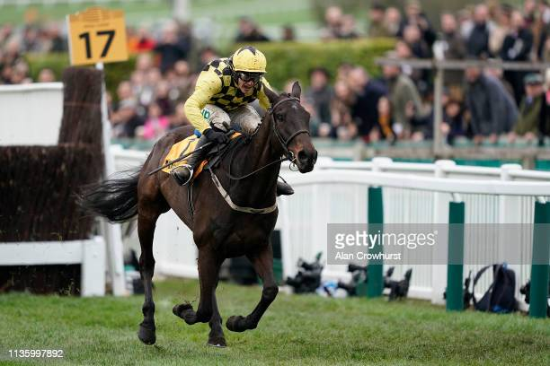 Paul Townend riding Al Boum Photo clear the last to win The Magners Cheltenham Gold Cup Steeple Chase on Gold Cup Day at Cheltenham Racecourse on...