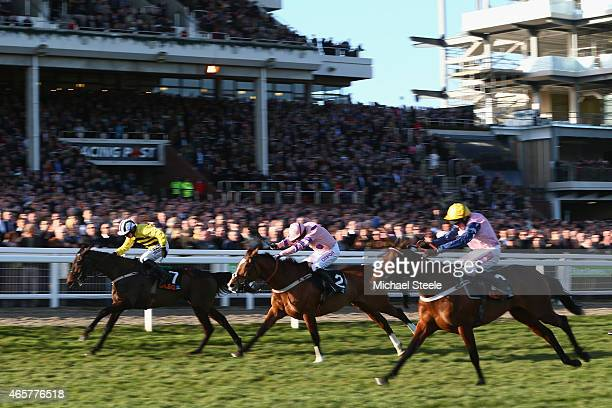 CHELTENHAM ENGLAND MARCH 10 Paul Townend riding Glens Melody on his way to victory from Noel fehily riding Bitofapuzzle and Barry Geraghty riding...