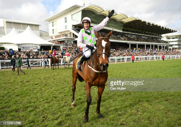 Paul Townend riding Min celebrates winning the Ryanair Chase at Cheltenham Racecourse on March 12 2020 in Cheltenham England
