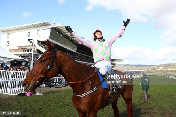 Paul Townend riding Monkfish celebrates victory in the Albert Bartlett Novices' Hurdle at Cheltenham Racecourse on March 13, 2020 in Cheltenham,...
