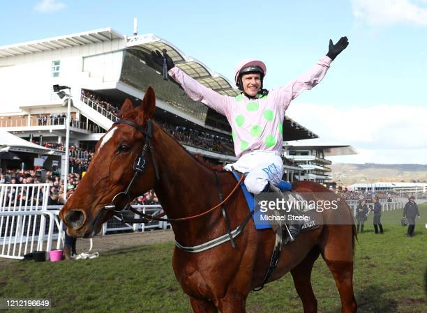 Paul Townend riding Monkfish celebrates victory in the Albert Bartlett Novices' Hurdle at Cheltenham Racecourse on March 13 2020 in Cheltenham England