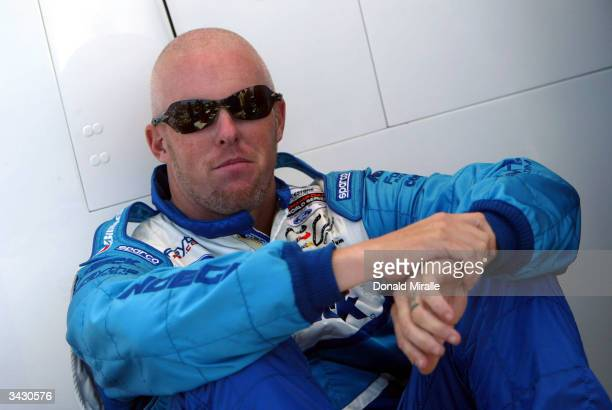 Paul Tracy driver of the Indeck Forsythe Championship Racing Ford Cosworth Lola looks on before the start of qualifying for the Toyota Grand Prix of...