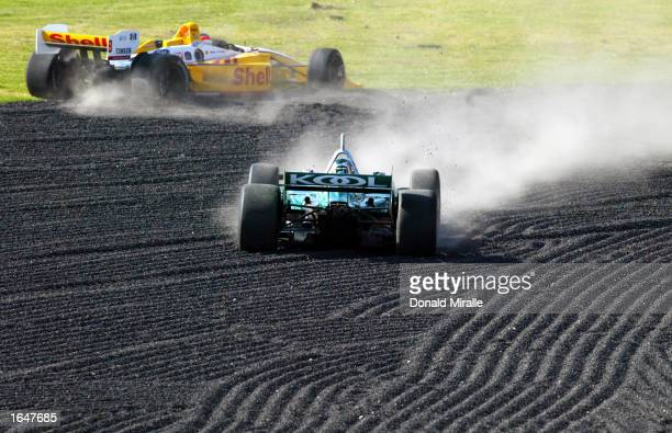 Paul Tracy in the Team KOOL Green Honda Lola spins off after making contact with the Shell Team Rahal Ford Lola of Jimmy Vasser during the Gran...