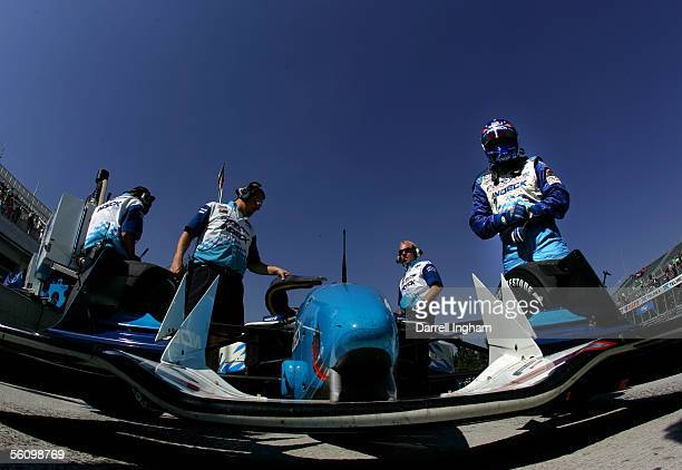 Paul Tracy stands beside the Indeck Forsythe Racing Lola Ford Cosworth during practice for the ChampCar World Series Gran Premio TelmexTecate on...