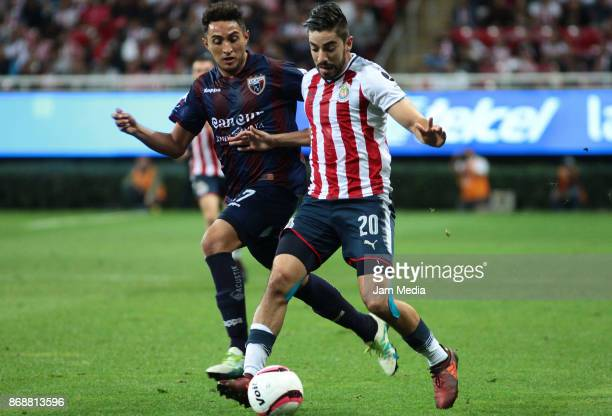 Paul Uscanga of Atlante fights for the ball with Rodolfo Pizarro of Chivas during the quarter final match between Chivas and Atlante as part of the...
