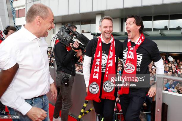 Paul van Kemenade Andre Ooijer of PSV assistant trainer Chris van der Weerden of PSV Celebrate the championship during the PSV champions parade at...