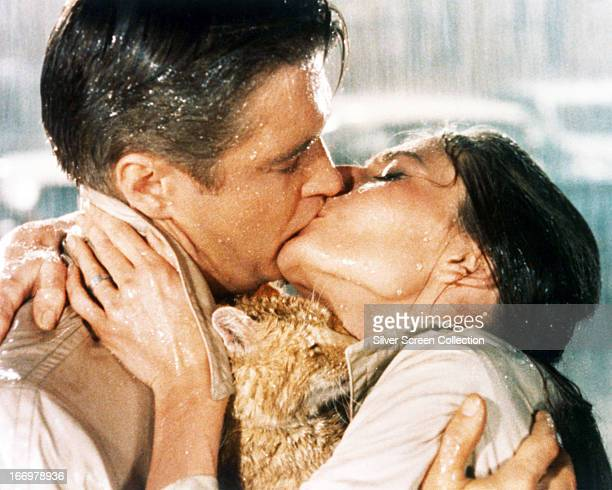 Paul Varjak, played by George Peppard , and Holly Golightly, played by Audrey Hepburn , kiss in a publicity still from 'Breakfast at Tiffany's',...