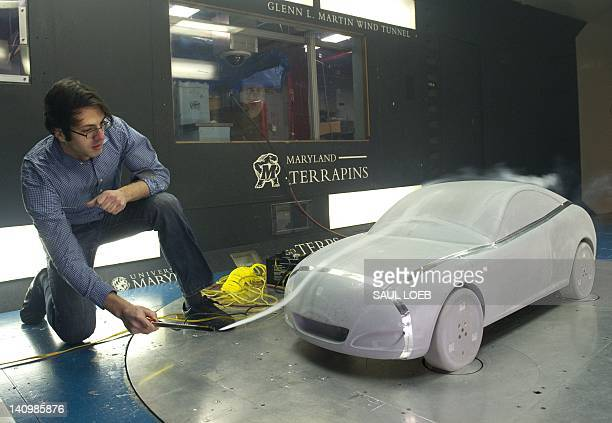 Paul Vasilescu director of Technology Development at American Dynamics Flight Systems uses smoke to examine the aerodynamics of the Genovation Cars...