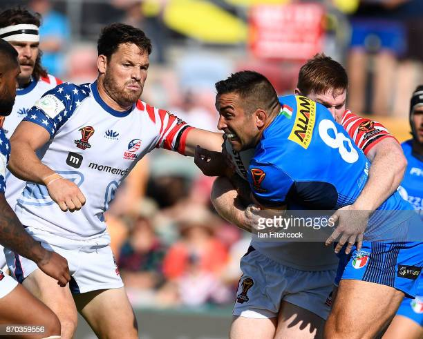 Paul Vaughan of Italy is wrapped up by the USA defence during the 2017 Rugby League World Cup match between Italy and the USA at 1300SMILES Stadium...