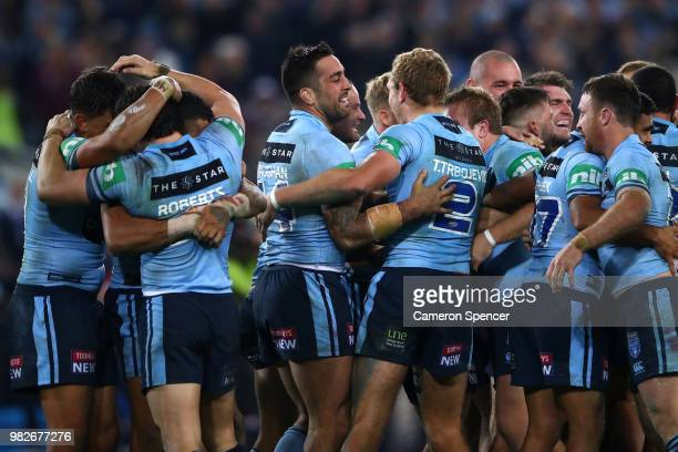 Paul Vaughan of the Blues and team mates celebrate winning game two of the State of Origin series between the New South Wales Blues and the...
