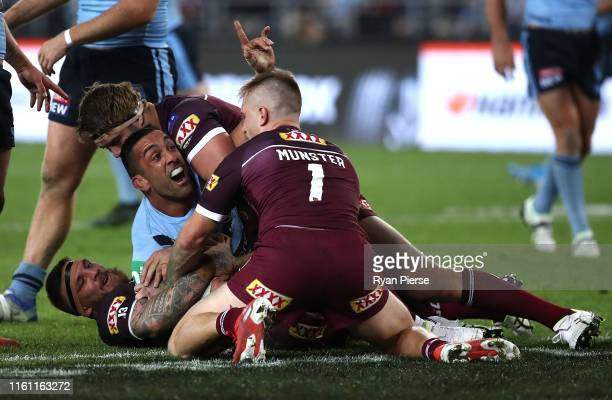 Paul Vaughan of the Blues celebrates after scoring a try during game three of the 2019 State of Origin series between the New South Wales Blues and...