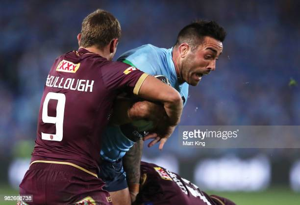 Paul Vaughan of the Blues is tackled during game two of the State of Origin series between the New South Wales Blues and the Queensland Maroons at...