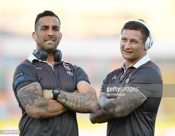Paul Vaughan of the Dragons and Tariq Sims of the Dragons looks on before the start of the round 19 NRL match between the North Queensland Cowboys...