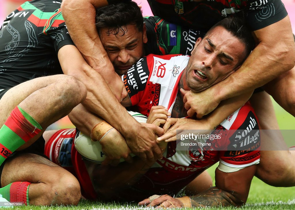 Paul Vaughan of the Dragons is tackled by the Rabbitohs defence during the round 10 NRL match between the South Sydney Rabbitohs and the St George Illawarra Dragons at ANZ Stadium on May 13, 2018 in Sydney, Australia.