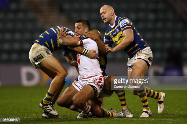 Paul Vaughan of the Dragons is tackled during the round 16 NRL match between the St George Illawarra Dragons and the Parramatta Eels at WIN Stadium...