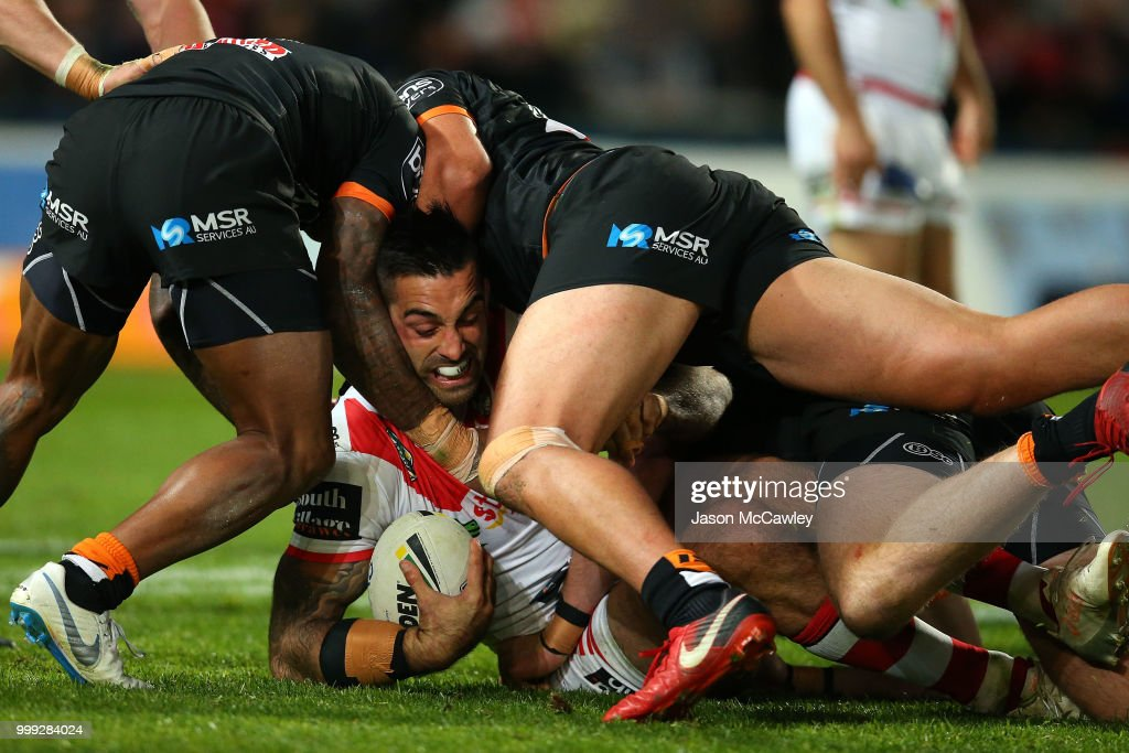 Paul Vaughan of the Dragons is tackled during the round 18 NRL match between the St George Illawarra Dragons and the Wests Tigers at UOW Jubilee Oval on July 15, 2018 in Sydney, Australia.