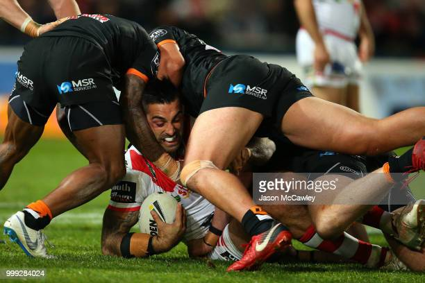 Paul Vaughan of the Dragons is tackled during the round 18 NRL match between the St George Illawarra Dragons and the Wests Tigers at UOW Jubilee Oval...