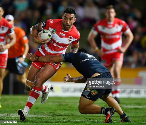 Paul Vaughan of the Dragons is tackled during the round 19 NRL match between the North Queensland Cowboys and the St George Illawarra Dragons at...