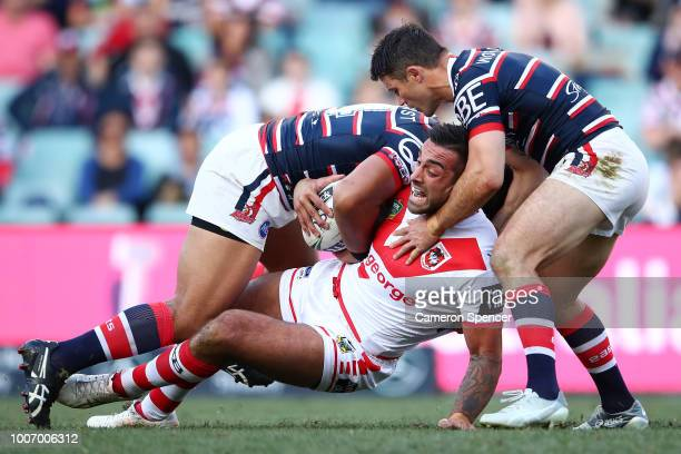 Paul Vaughan of the Dragons is tackled during the round 20 NRL match between the Sydney Roosters and the St George Illawarra Dragons at Allianz...