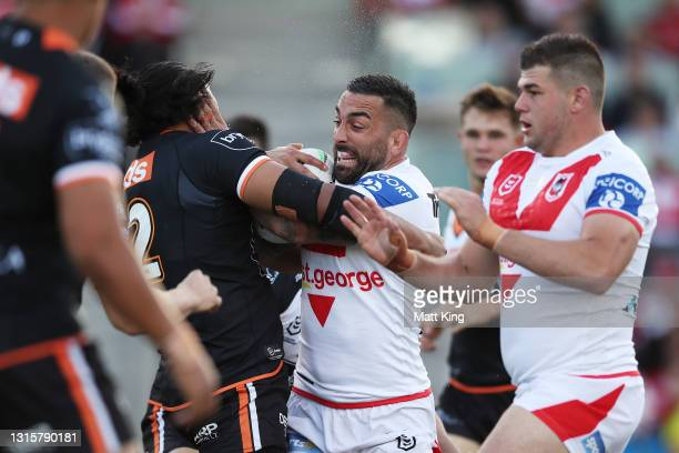 Paul Vaughan of the Dragons is tackled during the round eight NRL match between the St George Illawarra Dragons and the Wests Tigers at WIN Stadium,...