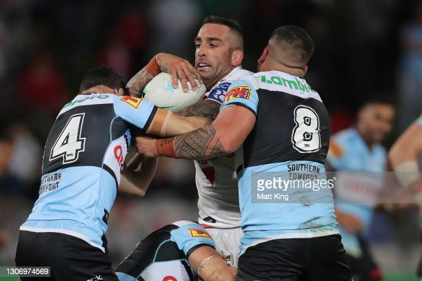 Paul Vaughan of the Dragons is tackled during the round one NRL match between the St George Illawarra Dragons and the Cronulla Sharks at Netstrata...