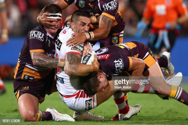Paul Vaughan of the Dragons is tackled during the round one NRL match between the St George Illawarra Dragons and the Brisbane Broncos at UOW Jubilee...