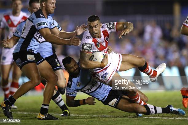 Paul Vaughan of the Dragons is tackled during the round two NRL match between the Cronulla Sharks and the St George Illawarra Dragons at Southern...