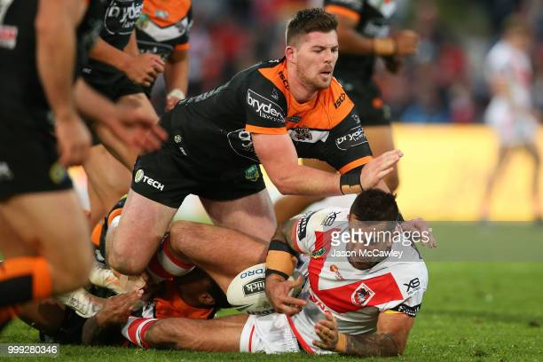 Paul Vaughan of the Dragons is tackled Matt Eisenhuth of the Tigers during the round 18 NRL match between the St George Illawarra Dragons and the...