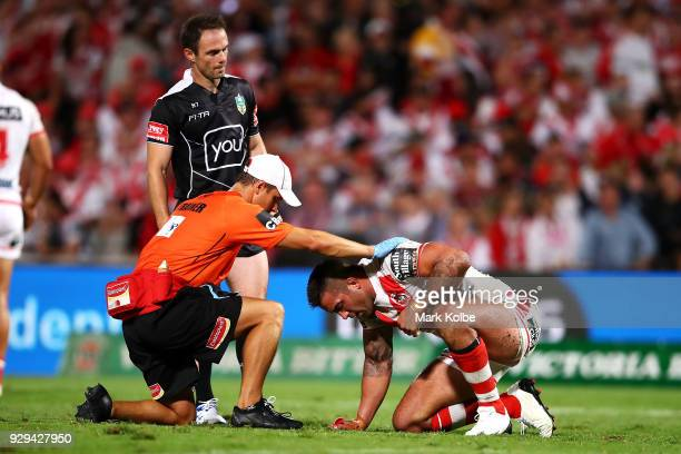 Paul Vaughan of the Dragons receives attention from the trainer during the round one NRL match between the St George Illawarra Dragons and the...