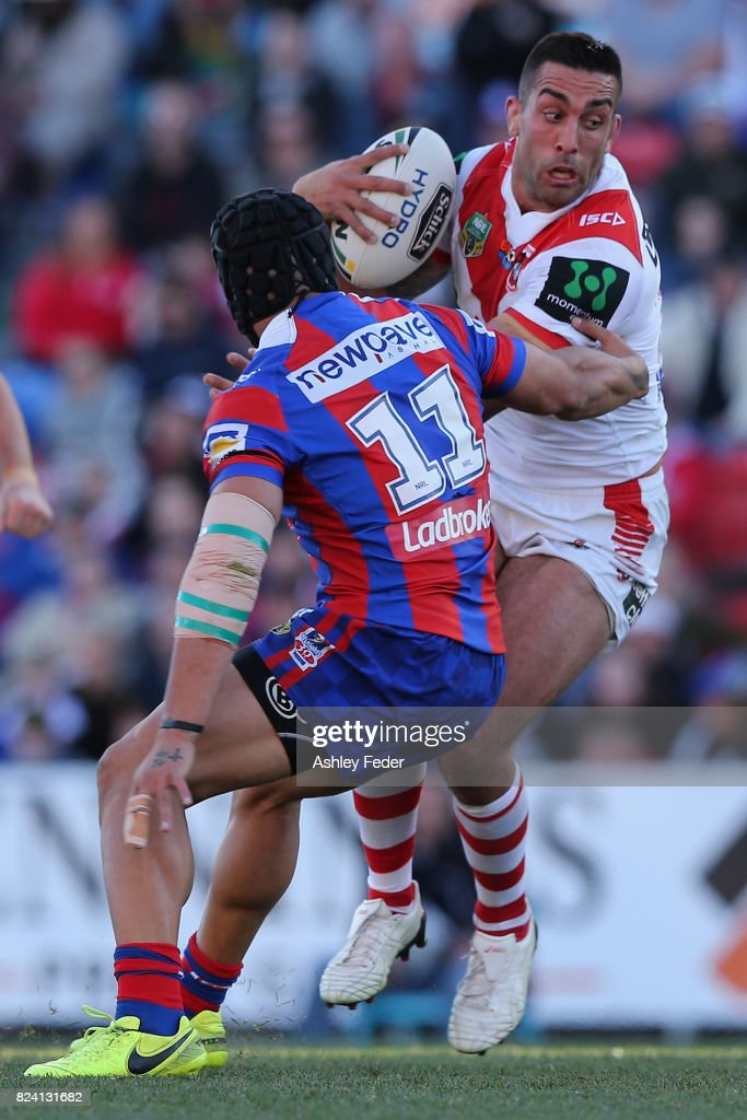 Paul Vaughan of the Dragos is tackled by the Knights defence during the round 21 NRL match between the Newcastle Knights and the St George Illawarra Dragons at McDonald Jones Stadium on July 29, 2017 in Newcastle, Australia.