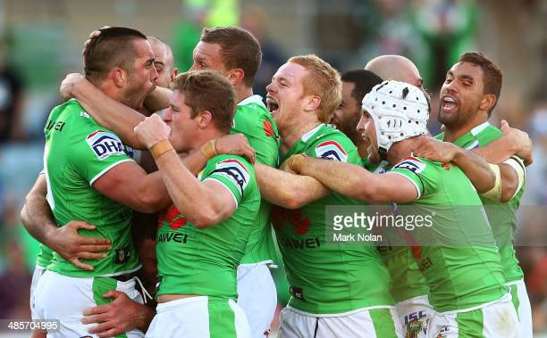 Paul Vaughan of the Raiders celebrates with team mates after scoring the match winning try during the round seven NRL match between the Canberra...