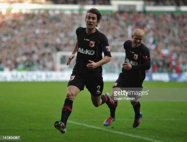 Paul Verhaegh of Augsburg celebrates scoring his goal with Tobias Werner during the Bundesliga match between SV Werder Bremen and FC Augsburg at...
