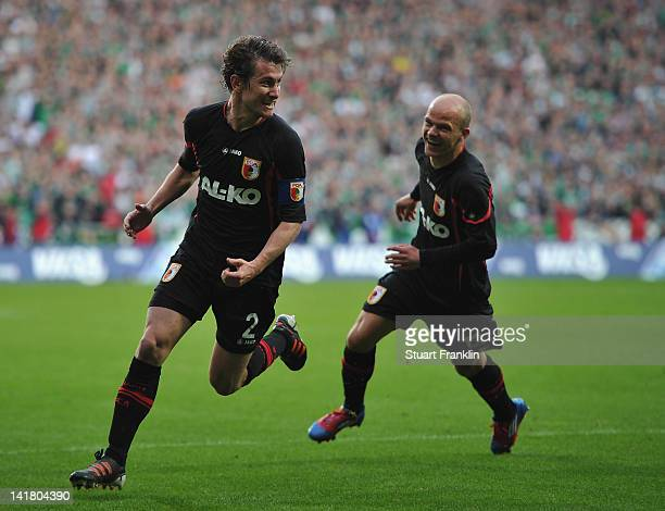Paul Verhaegh of Augsburg celebrates scoring his goal with Tobias Werner during the Bundesliga match between SV Werder Bremen and FC Augsburg at...