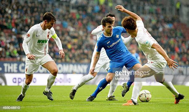 Paul Verhaegh of Augsburg Piotr Trochowski of Augsburg Jerome Gondorf of Darmstadt and JaCheol Koo of Augsburg compete for the ball during the...