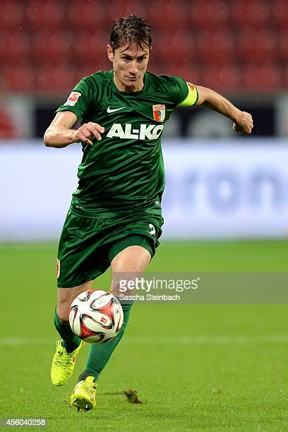 Paul Verhaegh of Augsburg runs with the ball during the Bundesliga match between Bayer 04 Leverkusen and FC Augsburg at BayArena on September 24 2014...