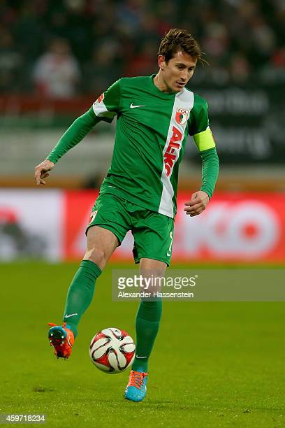 Paul Verhaegh of Augsburg runs with the ball during the Bundesliga match between FC Augsburg and Hamburger SV at SGL Arena on November 29 2014 in...