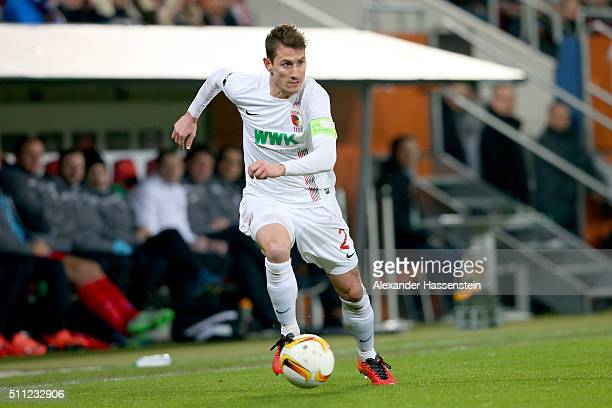 Paul Verhaegh of Augsburg runs with the ball during the UEFA Europa League round of 32 first leg match between FC Augsburg and Liverpool at WWKArena...