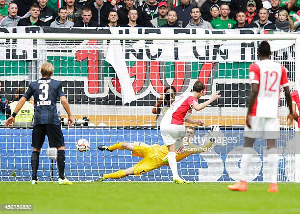Paul Verhaegh of Augsburg scores a penalty goal during the Bundesliga match between FC Augsburg and Hertha BSC at SGL Arena on September 28 2014 in...