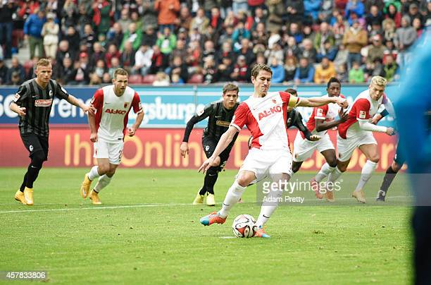 Paul Verhaegh of Augsburg scores a penalty goal during the FC Augsburg v SC Freiburg Bundesliga match at SGL Arena on October 25 2014 in Augsburg...