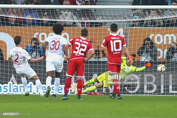 Paul Verhaegh of Augsburg scores the firts team goal with a penalty against Loris Karius keeper of Mainz during the Bundesliga match between FC...