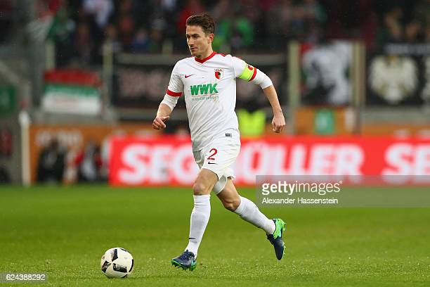 Paul Verhaegh of Ausgburg runs with the ball during the Bundesliga match between FC Augsburg and Hertha BSC at WWK Arena on November 19 2016 in...