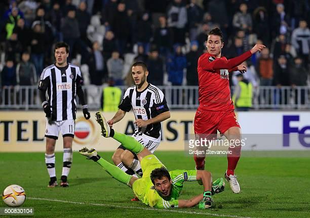 Paul Verhaegh of FC Augsburg scores the goal near goalkeeper Zivko Zivkovic of Partizan during the UEFA Europa League match between FK Partizan v FC...
