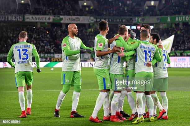 Paul Verhaegh of VfL Wolfsburg celebrates with a team after scoring from the penalty spot to make it 01 during the Bundesliga match between VfL...