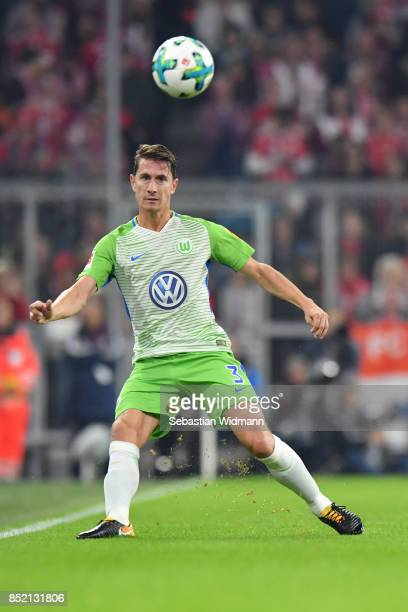 Paul Verhaegh of Wolfsburg plays the ball during the Bundesliga match between FC Bayern Muenchen and VfL Wolfsburg at Allianz Arena on September 22...