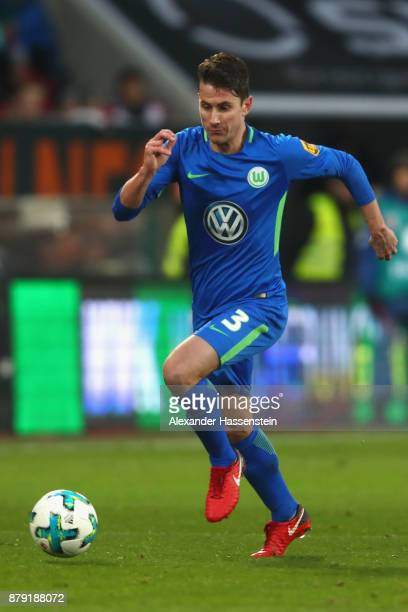 Paul Verhaegh of Wolfsburg runs with the ball during the Bundesliga match between FC Augsburg and VfL Wolfsburg at WWKArena on November 25 2017 in...