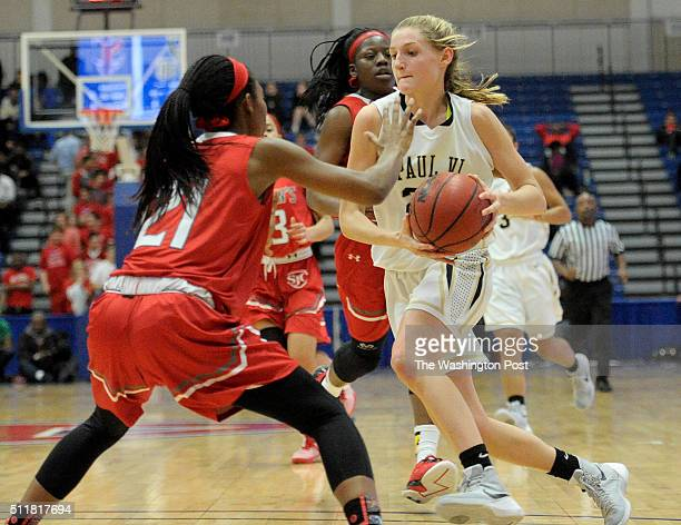Paul VI Panthers sophomore guard Kate Klimkiewicz drives up court attempting to get around St John's Cadets junior Aisha Sheppard in the first half...