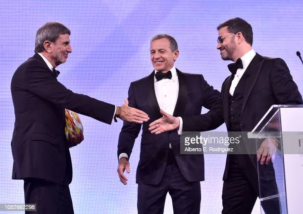 Paul Viviano and Walt Disney Company Chairman and CEO Bob Iger present the Courage to Care Award to Jimmy Kimmel onstage at the 2018 Children's...