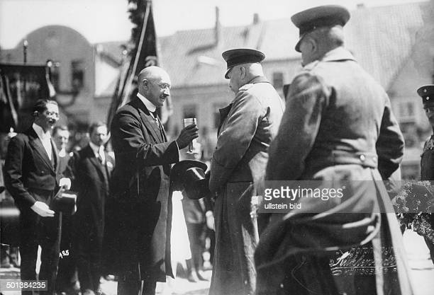 Paul von Hindenburg German field marshal and statesman 2nd President of Gemany 192534 Hindenburg visiting East Prussia in 1922 is presented a welcome...