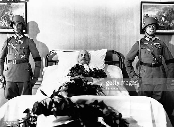Paul von Hindenburg the president of the Weimar Republic lies on his death bed while two soldiers stand guard nearby
