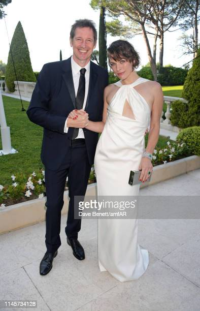 Paul W. S. Anderson and Milla Jovovich attend the amfAR Cannes Gala 2019 at Hotel du Cap-Eden-Roc on May 23, 2019 in Cap d'Antibes, France.